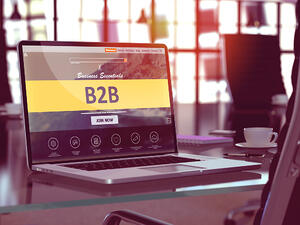 B2B - Business to Business - Concept - Closeup on Laptop Screen in Modern Office Workplace. Toned Image with Selective Focus. 3d Render.-1