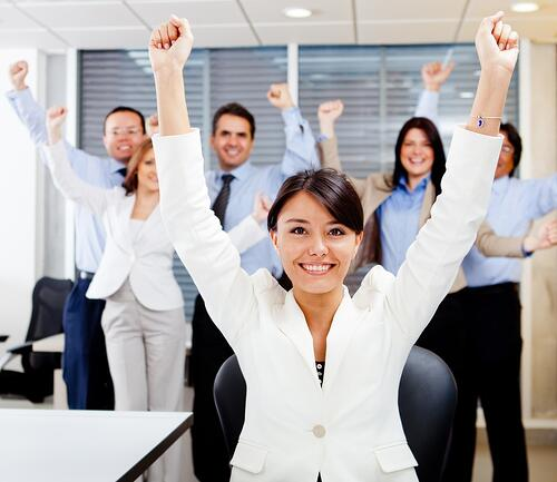 Business woman leading a successful group with arms up
