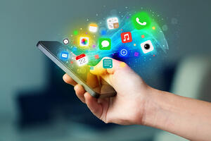 Hand holding smartphone with colorful app icons concept-1