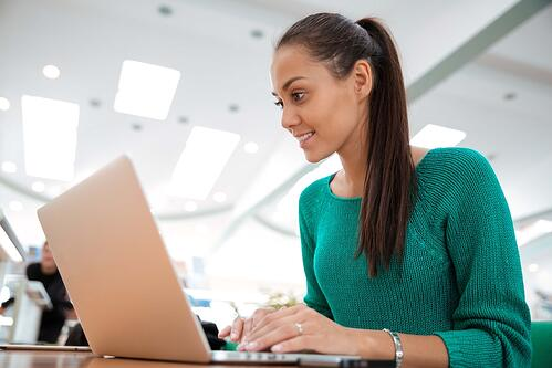 lady sitting at a desk using her laptop