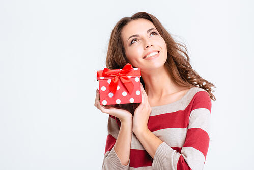 lady wearing a red and white striped sweater holding a gift