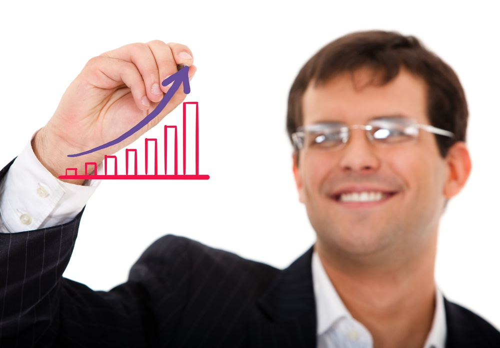 business man drawing a growth graph isolated