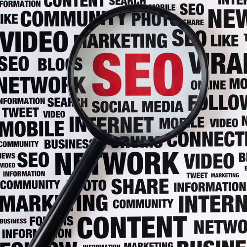 adWhite On-page SEO vs. Off-page SEO Primer Marketing Keywords in Black SEO Bold in Red Highlighted by a Magnifying Glass